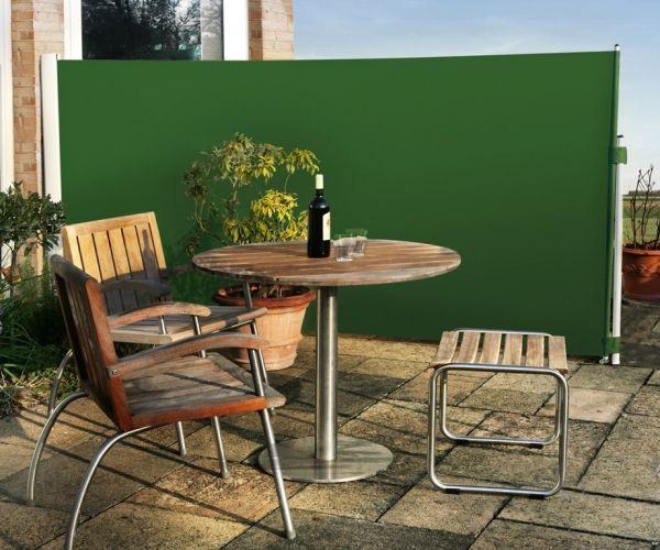 Patio wind break plain green awning for Garden windbreak designs